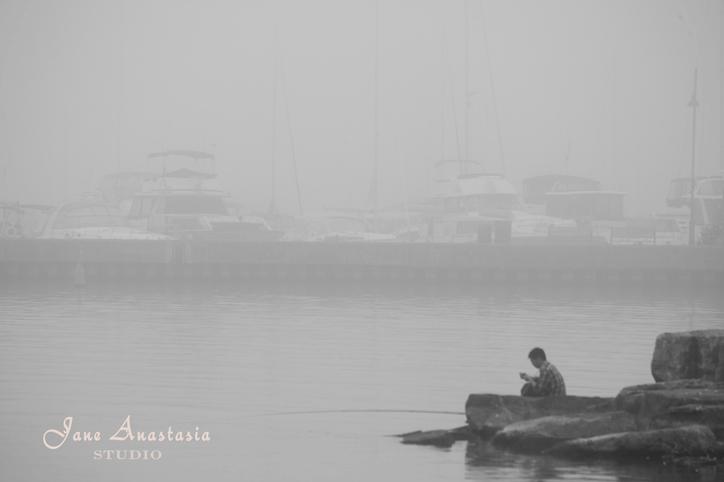 _JAS8480-WEB-Boy-texting-in-the-fog